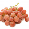 Stock Photo: Red fresh grapes isolated on white