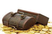 Wooden casket full of coins isolated — Stock Photo
