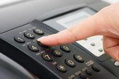 The hand presses the fax button — Stock Photo