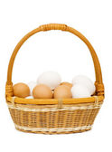 Eggs in a basket on a white background — Stock Photo