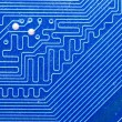 Close up of computer circuit board in blue - Stock Photo