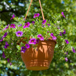 Basket with flowers in park — Stock Photo