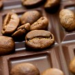 Background from coffee beans and chocolate — Stock Photo