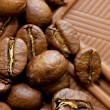 Background from coffee beans and chocolate — Stock Photo #3501619
