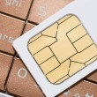 Cellphone and sim card — Stock Photo