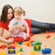 Mum with the daughter play to a room — Stock Photo #3578359
