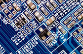 Close up of computer circuit board in blue — Stock Photo