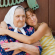 Grandmother and granddaughter embraced and happy - Stok fotoğraf