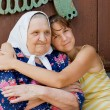 Grandmother and granddaughter embraced and happy — Стоковая фотография