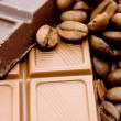 Background from coffee beans and chocolate — Stock Photo #3636837