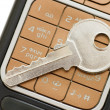 Stock Photo: Cellphone and key isolated on white background