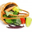 Wattled basket with vegetables isolated on white - Stock Photo