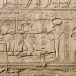 Egyptian hieroglyphs. Pattern from Karnak Temple, location: Luxor, Egypt - Stock Photo