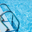 Swimming pool with stair at hotel close up — Stock Photo