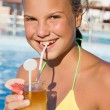 The girl with a cocktail at pool — Stock Photo
