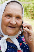 Grandmother talking with a phone — Stock Photo