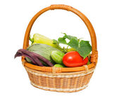 Wattled basket with vegetables isolated on white — Stock Photo