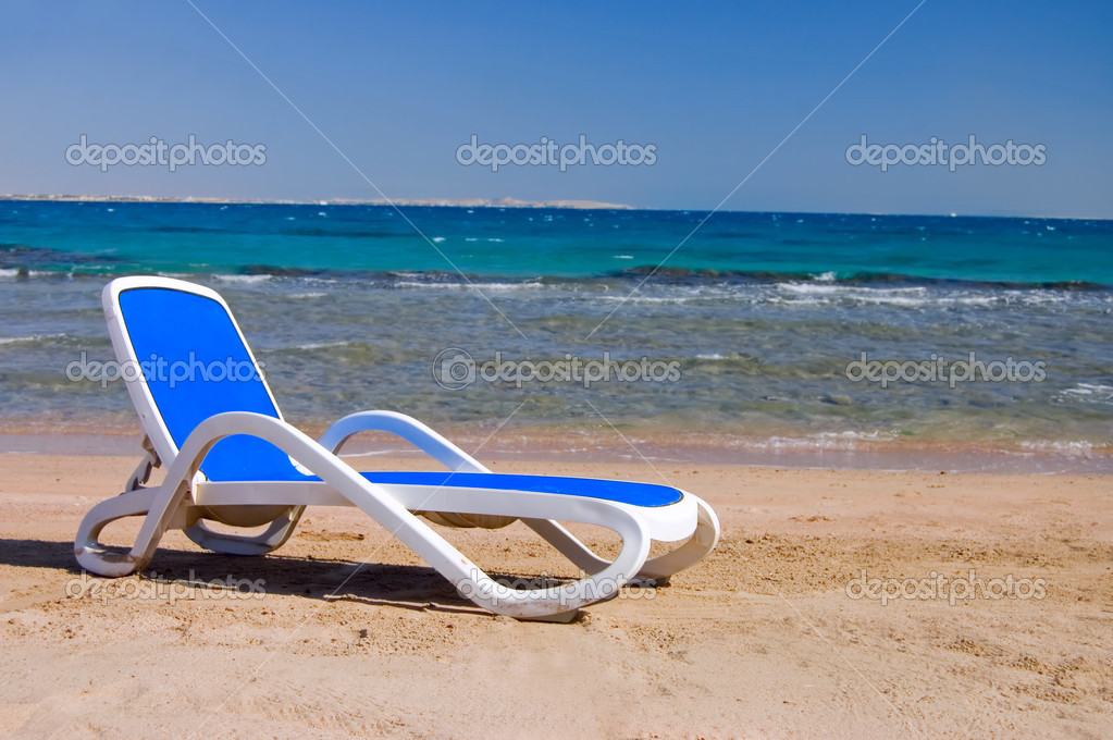 Dark blue chaise lounge at the sea  Stock Photo #3865250