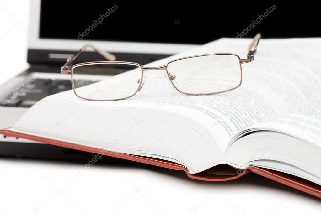Eyeglasses and books on the laptop  — Stock Photo #3911625