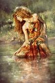 Beautiful woman enjoys the water. — Stock Photo