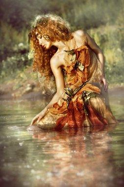 Beautiful woman enjoys the water.