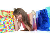 The beautiful girl with purchases — Stock Photo