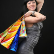 The beautiful girl in dress with shopping bags — Stock Photo