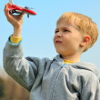 Little boy is playing with toy airplane — Stock Photo