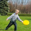 Little boy is playing Frisbee — Stock Photo
