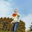 Handsome young man is playing Frisbee — Stock Photo