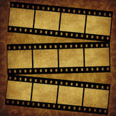 Grunge graphic abstr backgr with film — Stock Photo