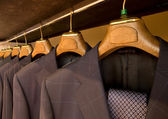 Hanging designer suits — Stock fotografie