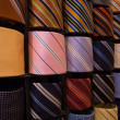 Elegant italian neckties in a tie rack — Stock Photo #3060993