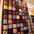 Stock Photo: Elegant italian neckties in a tie rack