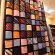 Elegant italian neckties in a tie rack — Stock Photo