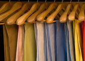 Colorful pants wooden hangers — Stok fotoğraf