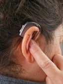 Woman wearing hearing aid — Stock Photo