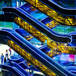 Blue and yellow escalators - Stock Photo