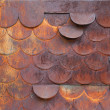 Rusty cladding on old Swiss building - Stock Photo