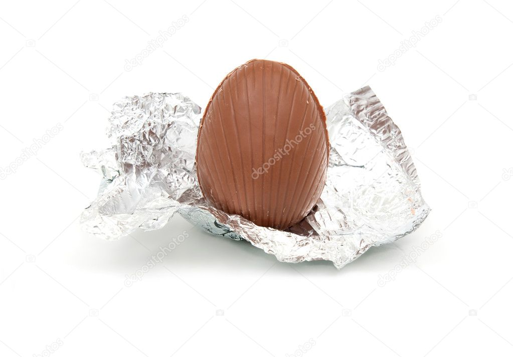 Unwrapped chocolate egg in silver foil wrapper    #2835016