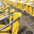 Yellow cafe chairs in San Marco Piazza — Stock Photo