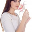 Young lovely brunette with lily — Stock Photo