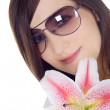 Lovely woman in sunglasses with lili — Stock Photo #2762388