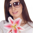 Lovely woman in sunglasses with lili - Stock Photo