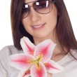Woman in sunglasses with lili — Stock Photo #2762424