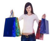 Happy woman with shopping bags over white — Stock Photo