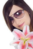 Lovely woman in sunglasses with lili — Stock Photo