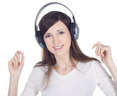 Young woman in headphones listening music — Stock Photo