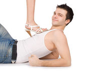 Brightly picture of young man holding female leg — Stock Photo