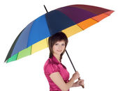 Lovely young lady standing with color umbrella — Stock Photo